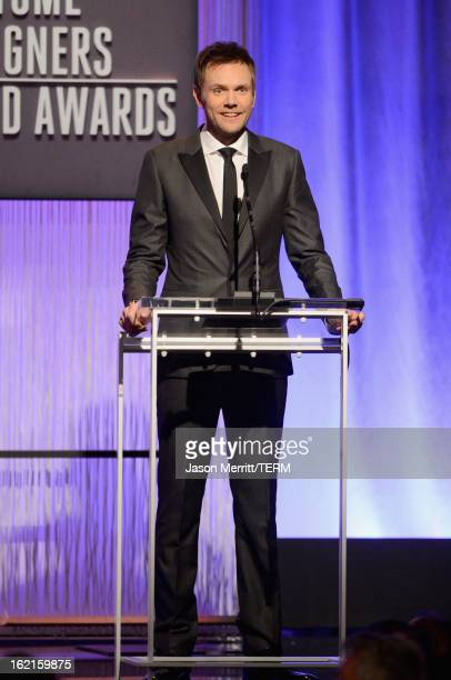 Host Joel McHale onstage during the 15th Annual Costume Designers Guild Awards with presenting sponsor Lacoste at The Beverly Hilton Hotel on...