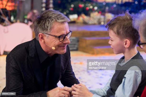 Host Joerg Pilawa talks to an boy during the New Year's Eve tv show hosted by Joerg Pilawa on December 30 2017 in Graz Austria