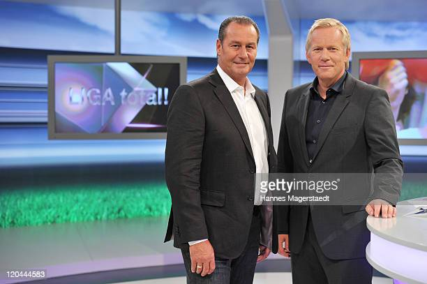 TV host Johannes B Kerner and Dutch football manager Huub Stevens pose during the LIGA total TV show on August 6 2011 in Ismaning near Munich Germany