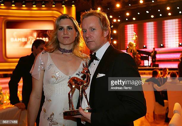TV host Johannes B Kerner poses with his wife Britta BeckerKerner and his trophy on their way to the after show party of the 57th annual Bambi Awards...