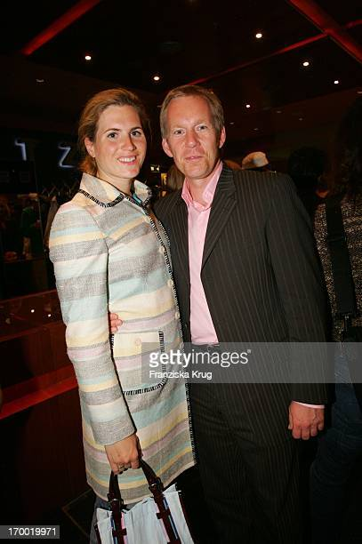 Host Johannes B Kerner with wife Britta Becker In The European premiere of War of the Worlds In the theater at Potsdamer Platz in Berlin