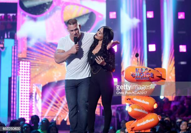 Host John Cena and professional wrestler Nikki Bella speak onstage at Nickelodeon's 2017 Kids' Choice Awards at USC Galen Center on March 11 2017 in...