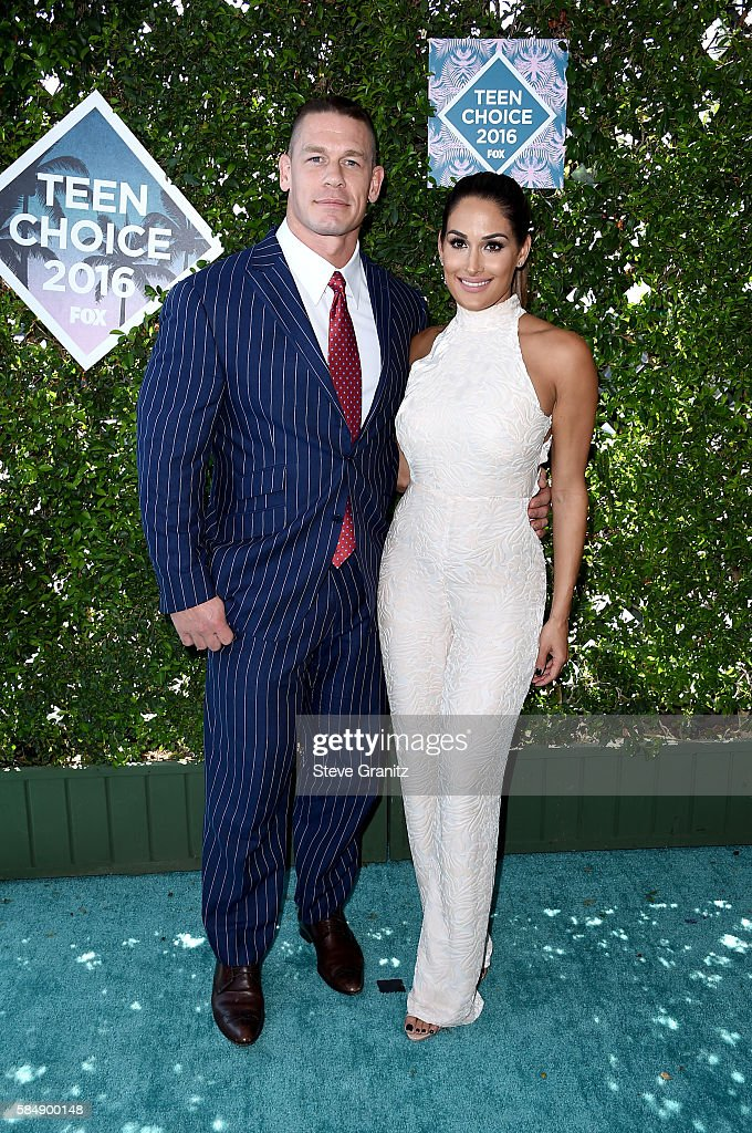 Host John Cena (L) and WWE Diva Nikki Bella attend Teen Choice Awards 2016 at The Forum on July 31, 2016 in Inglewood, California.