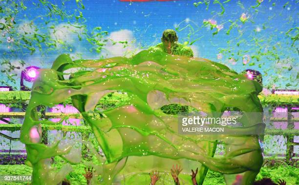 Host John Cena gets slimed onstage at the 31st Annual Nickelodeon Kids' Choice Awards on March 24 2018 at the Forum in Inglewood California / AFP...