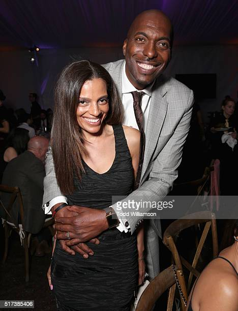 Host John Salley and Natasha Duffy attend UCLA IOES celebration of the Champions of our Planet's Future on March 24 2016 in Beverly Hills California