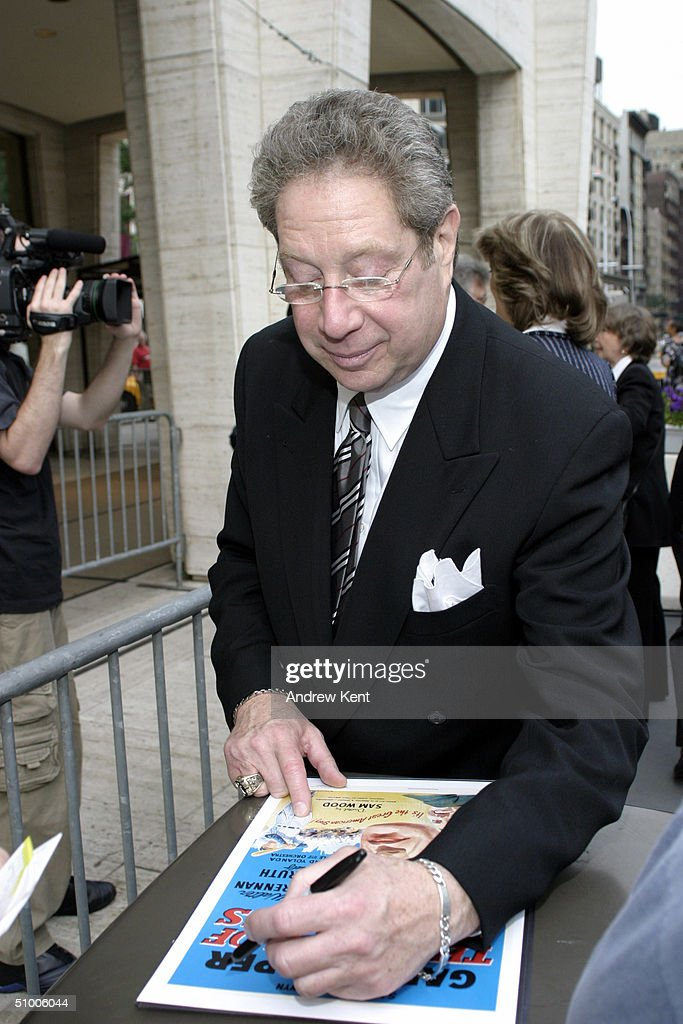 Host John Sterling signs autographs outside before MODA Entertainment's Tribute Screening Of 'Pride Of The Yankees' at Lincoln Center on June 28, 2004 in New York City.