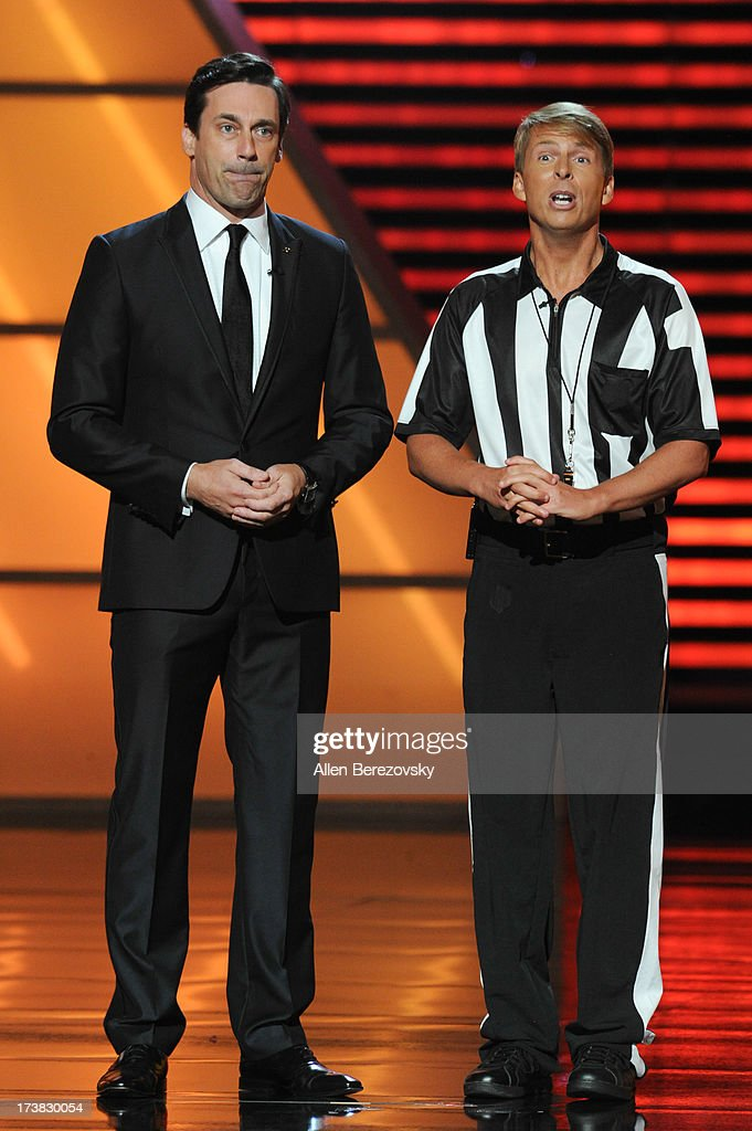 Host Jon Hamm and comedian Jack McBrayer speak onstage at the 2013 ESPY Awards at Nokia Theatre L.A. Live on July 17, 2013 in Los Angeles, California.