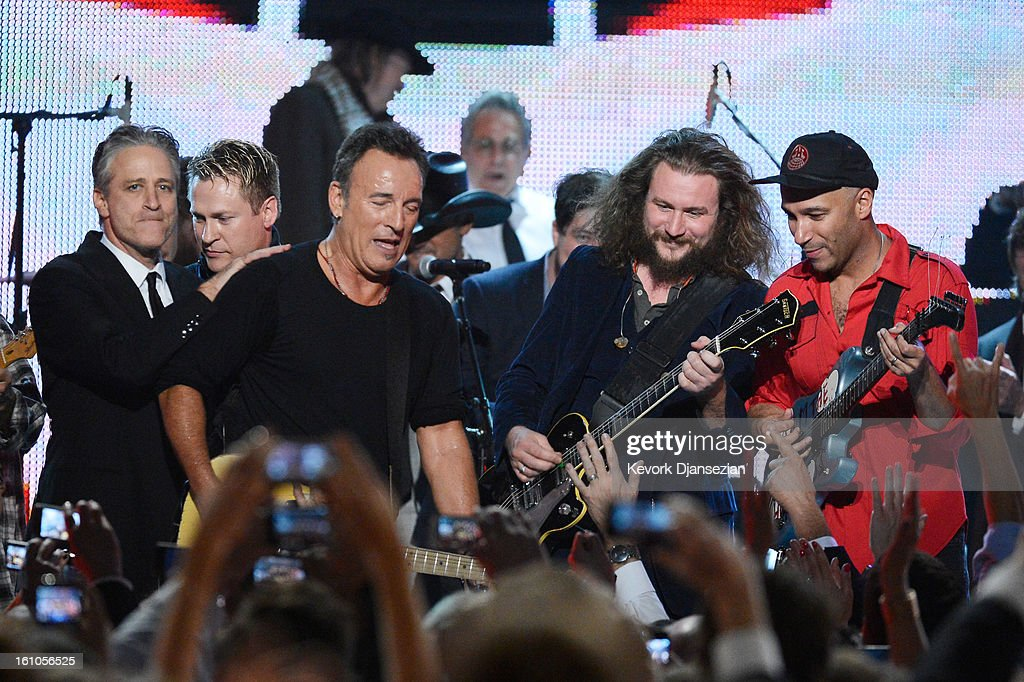 Host Jon Stewart, honoree Bruce Springsteen, singer Jim James and guitarist Tom Morello perform onstage at The 2013 MusiCares Person Of The Year Gala Honoring Bruce Springsteen at Los Angeles Convention Center on February 8, 2013 in Los Angeles, California.