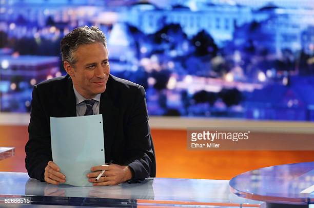 Host Jon Stewart of Comedy Central's 'The Daily Show with Jon Stewart' watches a video while taping 'The Daily Show with Jon Stewart Restoring Honor...