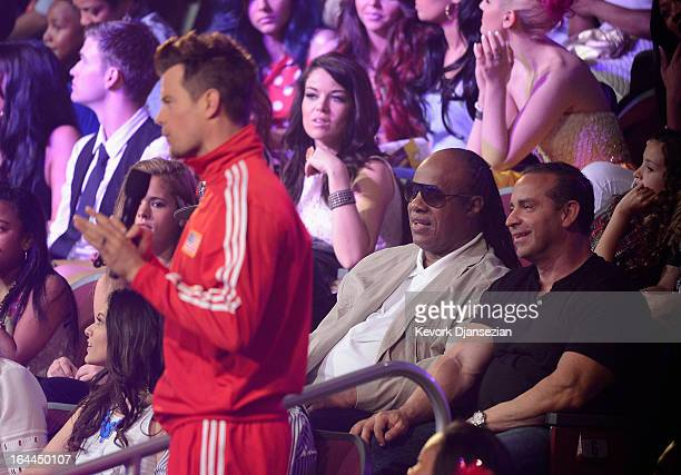 Host Josh Duhamel speaks onstage as musician Stevie Wonder looks on during Nickelodeon's 26th Annual Kids' Choice Awards at USC Galen Center on March...