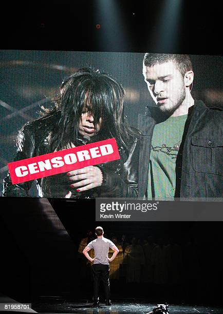 Host Justin Timberlake stands onstage in front of a video of himself and Janet Jackson from Super Bowl XXXVIII onstage at the 2008 ESPY Awards held...