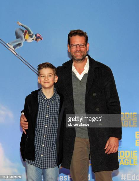 TV host Kai Boecking and his son Luca arrive for a special screening of 'Eddie The Eagle' in Munich Germany 20 March 2016 Photo Ursula Dueren/dpa |...