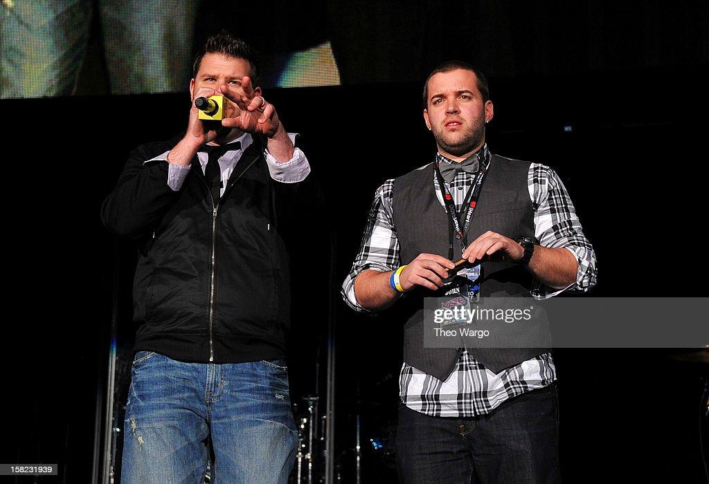 Host Kane and Intern John of The Kane Show speak onstage