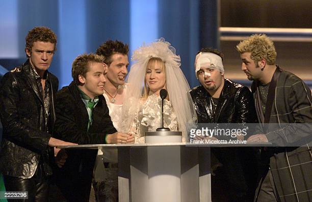 Host Kathy Griffin center is surrounded by some battered and beaten members of 'N Sync at the 2000 Billboard Music Awards at the MGM Grand Hotel and...