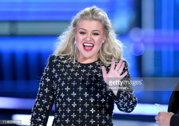 Host Kelly Clarkson speaks onstage during the 2019 Billboard Music Awards at MGM Grand Garden Arena on May 01 2019 in Las Vegas Nevada