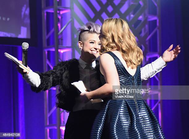 Host Kelly Osbourne and contestant Erin Timony speak onstage during the 4th Annual NYX FACE Awards at Club Nokia on August 22 2015 in Los Angeles...