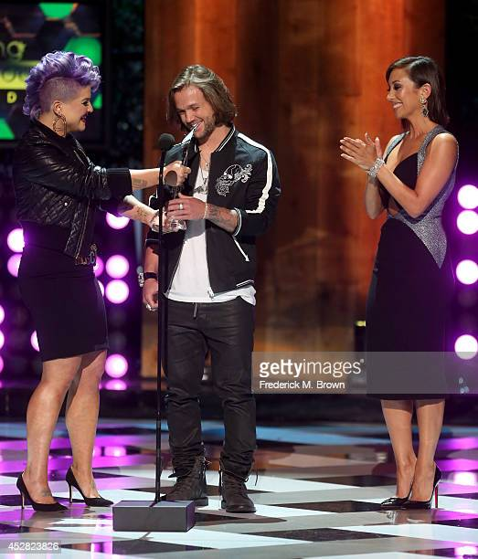 Host Kelly Osbourne the winner of Most Awesome Athlete Award Professional Snowboarder Louie Vito and TV Personality Cheryl Burke onstage at the 2014...