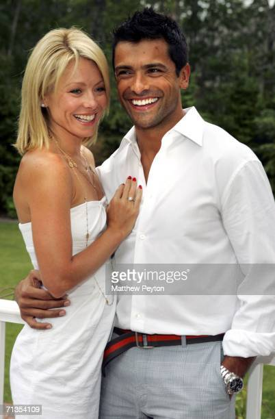 Host Kelly Ripa and her husband Mark Consuelos pose at the party to celebrate Ripa appearing as the cover of the latest Hamptons Magazine at Cain...