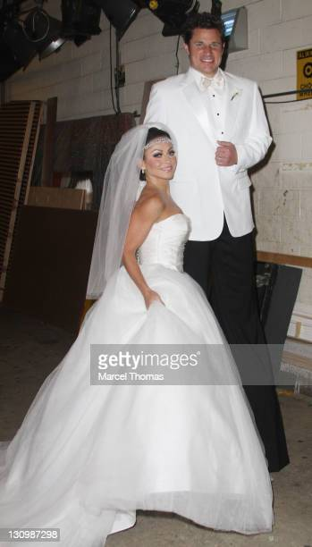 Host Kelly Ripa is seen in her Halloween costume as Kim Kardashian with musician Nick Lachey as Kris Humphries at the ABC TV studios on October 31,...