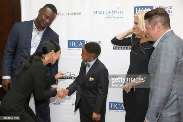 Host Kevin Carter Sema Carter MakeAWish child Kayden Allison Alderson and host Jay DeMarcus greet each other at the 17th annual Waiting for Wishes...