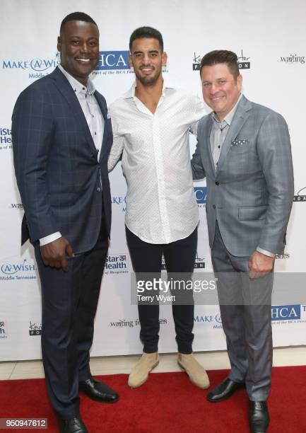 Host Kevin Carter Titans quarterback Marcus Mariota and host Jay DeMarcus attend the 17th annual Waiting for Wishes celebrity dinner at The Palm on...