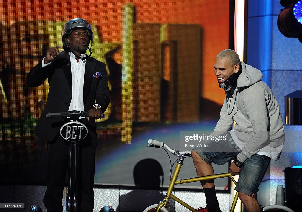 Host Kevin Hart (L) and singer Chris Brown speak onstage during the BET Awards '11 held at the Shrine Auditorium on June 26, 2011 in Los Angeles, California.