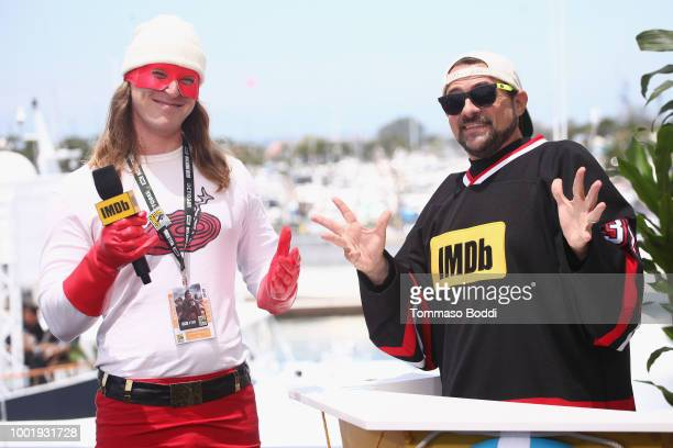 Host Kevin Smith and a fan attend the #IMDboat At San Diego ComicCon 2018 Day One at The IMDb Yacht on July 19 2018 in San Diego California