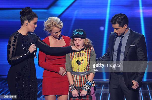 """Host Khloe Kardashian Odom, judge Britney Spears, eliminated contestant Beatrice Miller and host Mario Lopez onstage at FOX's """"The X Factor"""" Season 2..."""