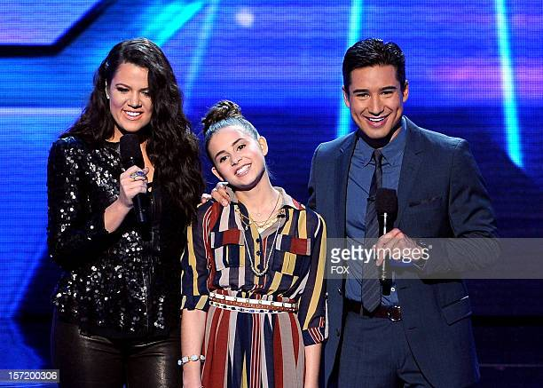 """Host Khloe Kardashian, top contestant Carly Rose Sonenclar and host Mario Lopez onstage at FOX's """"The X Factor"""" Season 2 Top 8 to 6 Live Elimination..."""