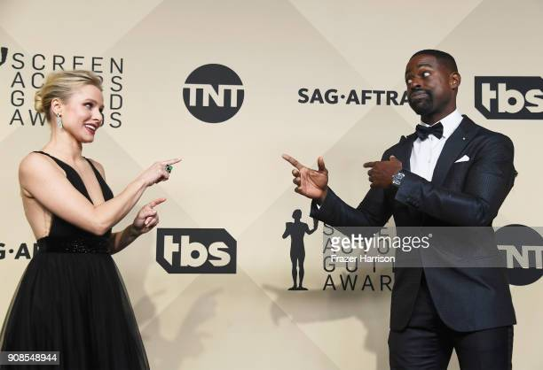 Host Kristen Bell and actor Sterling K Brown winner of Outstanding Performance by a Male Actor in a Drama Series and Outstanding Performance by an...