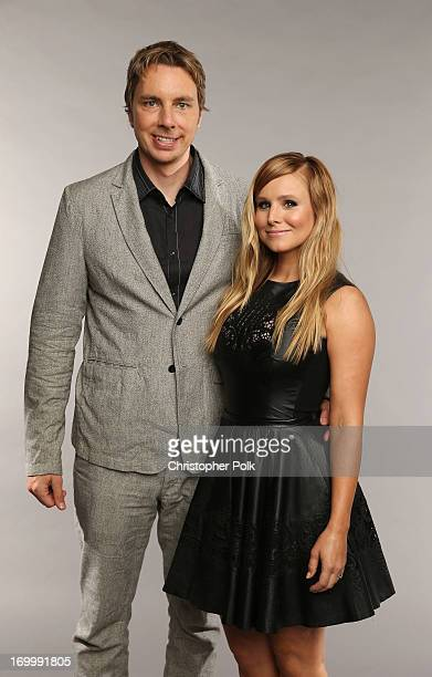 Host Kristen Bell poses with actor Dax Shepard at the Wonderwall portrait studio during the 2013 CMT Music Awards at Bridgestone Arena on June 5 2013...
