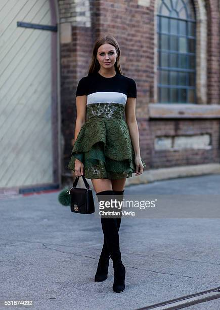 TV host Ksenija Lukich wearing a Alex Perry dress and Stuart Weitzman boots at MercedesBenz Fashion Week Resort 17 Collections at Carriageworks on...