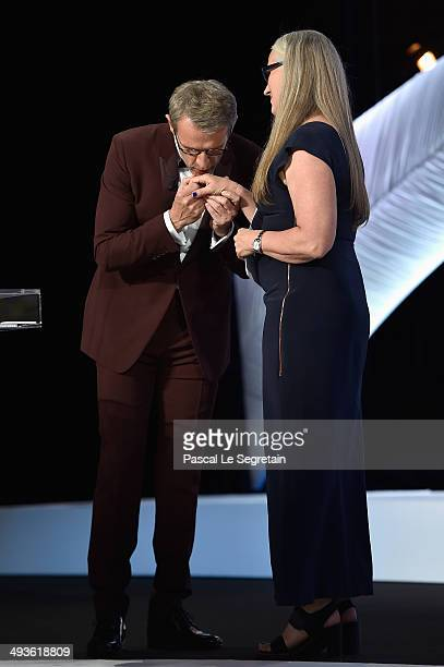 Host Lambert Wilson kisses the hand of Jury President Jane Campion on stage during the Closing Ceremony at the 67th Annual Cannes Film Festival on...
