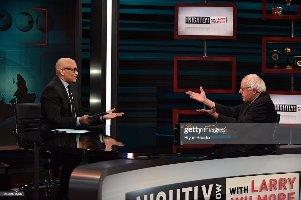 Host Larry Wilmore speaks with Senator Bernie Sanders on Comedy Central's 'The Nightly Show With Larry Wilmore' on January 5, 2016 in New York City.