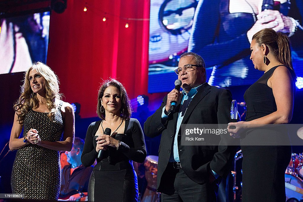 Host Lili Estefan, Gloria Estefan, editor of People En Español Armando Correa, and publisher of People En Español Monique Manso speak on stage during the Festival People en Español Presented by Target at The Alamodome on August 31, 2013 in San Antonio, Texas.
