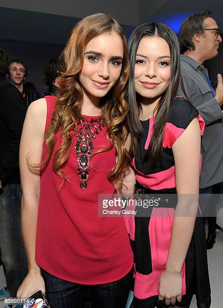 TV host Lily Collins poses with actress Miranda Cosgrove during the after party for Merry Christmas Drake Josh at the Westside Pavillion on December...