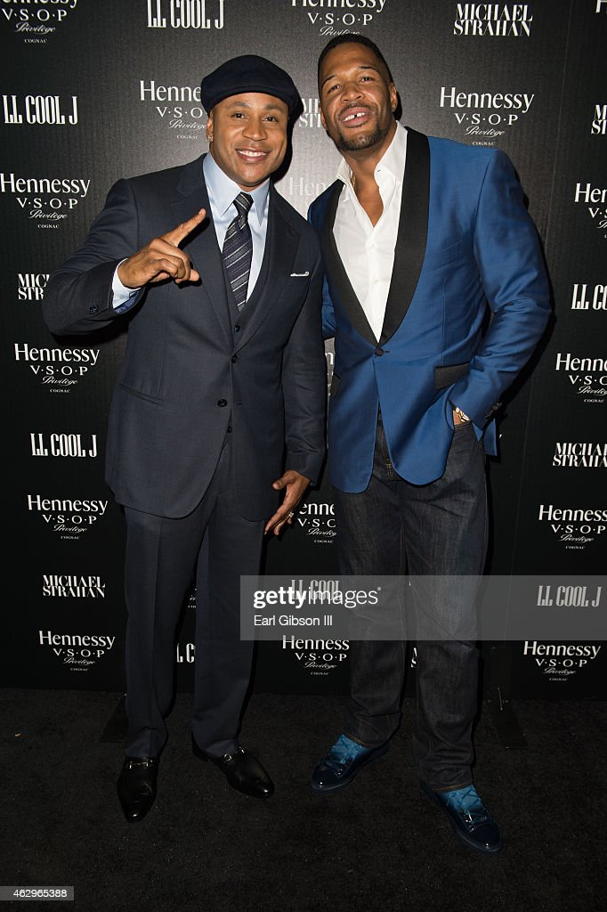 Host LL Cool J and Michael Strahan attend the Hennessy Toasts Achievements In Music Event on February 7, 2015 in Los Angeles, California.