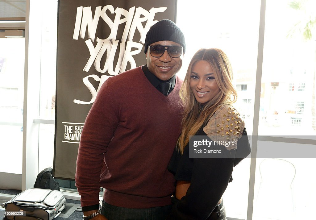 Host LL Cool J (L) and singer Ciara pose backstage at the GRAMMYs Dial Global Radio Remotes during The 55th Annual GRAMMY Awards at the STAPLES Center on February 8, 2013 in Los Angeles, California.