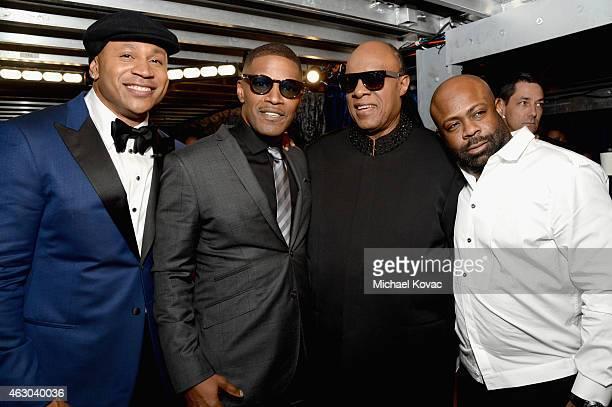 Host LL Cool J recording artist Jamie Foxx recording artist Stevie Wonder and Breyon Prescott attend The 57th Annual GRAMMY Awards at STAPLES Center...