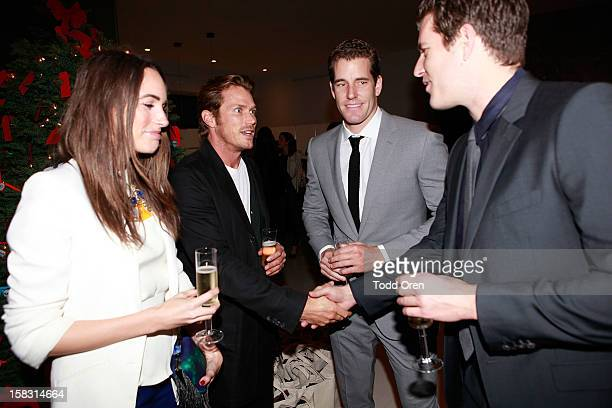 Host Louise Roe Actor Jason Lewis Cameron Winklevoss and Tyler Winklevoss pose at the Hukkster Holiday Party at a Private Residence on December 12...