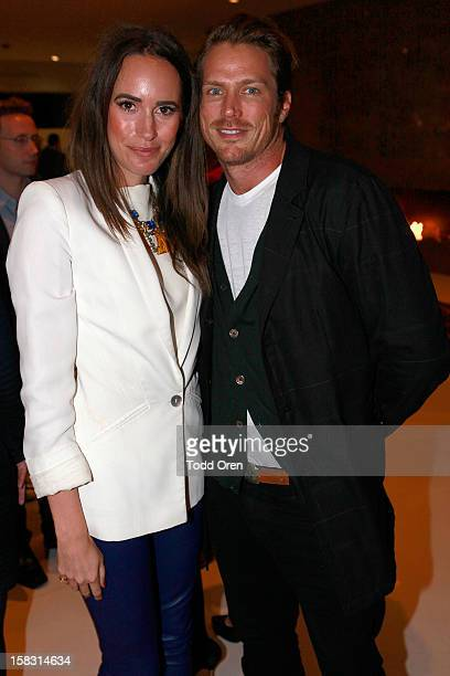 Host Louise Roe and actor Jason Lewis poses at the Hukkster Holiday Party at a Private Residence on December 12 2012 in Los Angeles California