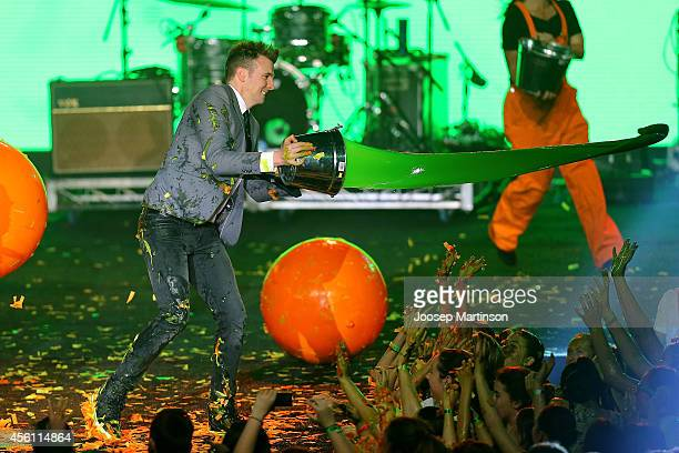 Host Luke Ryan throws slime during the Nickelodeon Slimefest 2014 matinee show at Sydney Olympic Park Sports Centre on September 26 2014 in Sydney...