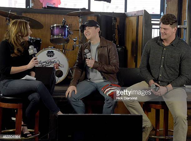 SI NOW Host Maggie Gray Singer/Songwriter Scotty McCreery and NFL Tennessee Titan player Taylor Lewan attend SI NOW at Tootsie's Orchid Lounge on...