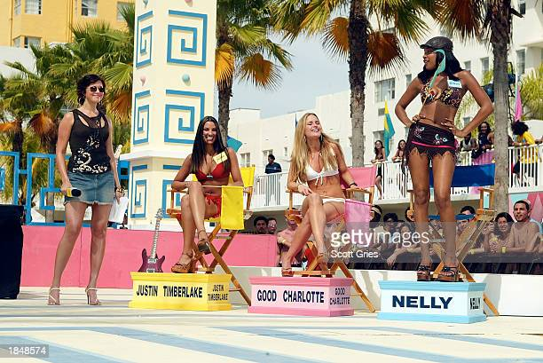 Host Mandy Moore with three contestants stand on stage during a taping for MTV Spring Break 2003 at the Surfcomber Hotel March 14 2003 in Miami Beach...