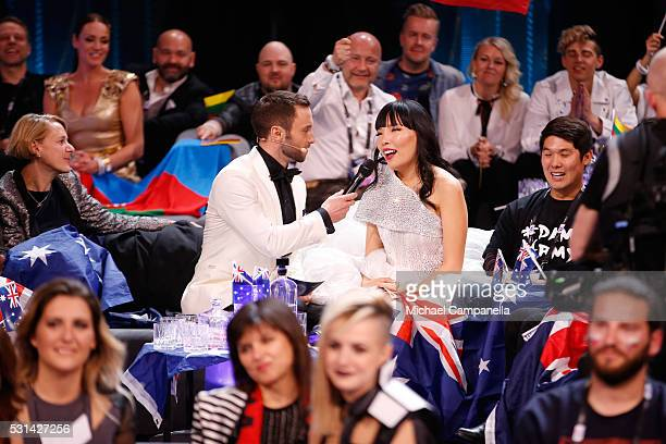 Host Mans Zelmerlow and Dami Im representing Australia is seen at the Ericsson Globe on May 14 2016 in Stockholm Sweden