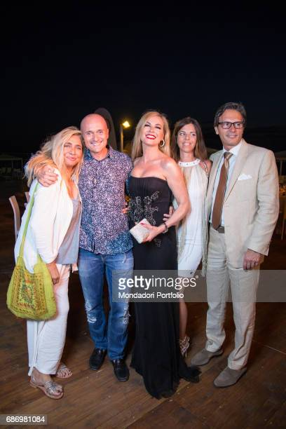 TV host Mara Venier Alfonso Signorini director of Chi and TV host Federica Panicucci having dinner in the beach resort Ostras Beach during the event...