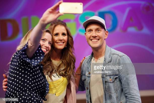 TV host Mareile Hoeppner Caroline Frier and Oliver Petszokat aka OliP take a selfie during the 'DINGSDA' photo call at MMC Studios on June 26 2018 in...