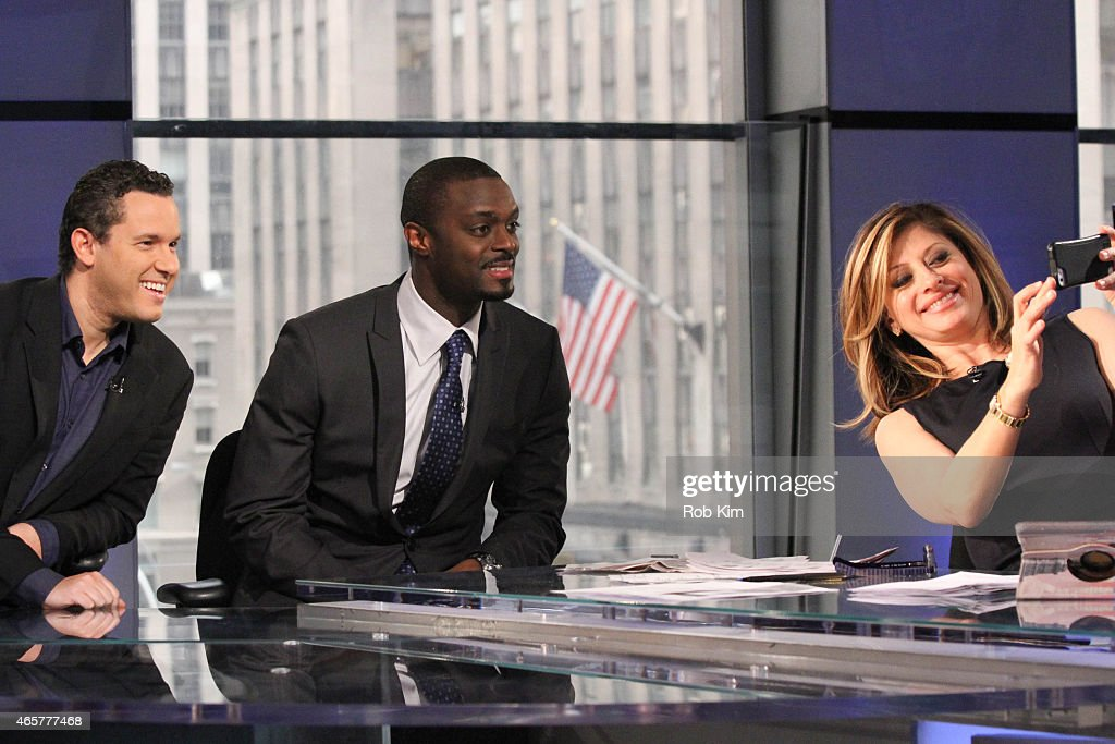 Host Maria Bartiromo takes a selfie photo with football player Plaxico Burress (C) and penny stock expert Timothy Sykes at 'Opening Bell With Maria Bartiromo' on the FOX Business Network at FOX Studios on March 10, 2015 in New York City.