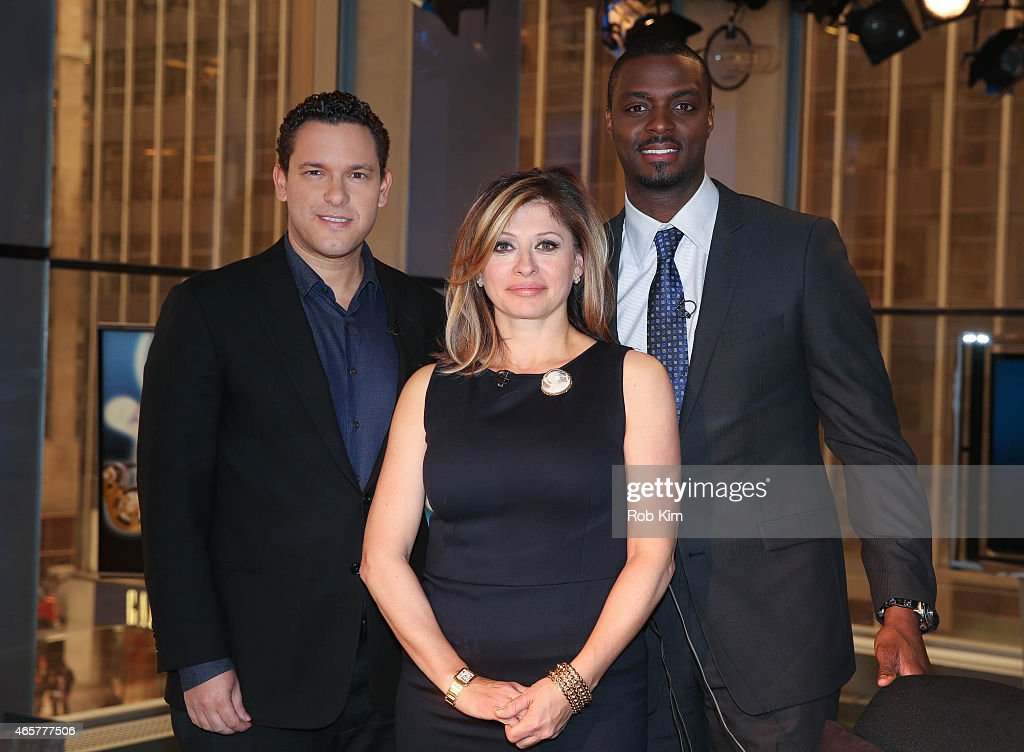 Host Maria Bartiromo with football player Plaxico Burress and penny stock expert Timothy Sykes appear on 'Opening Bell With Maria Bartiromo' on the FOX Business Network at FOX Studios on March 10, 2015 in New York City.