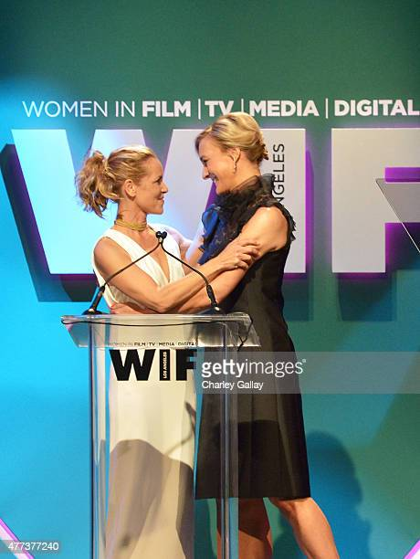 Host Maria Bello and Global Brand Ambassador for Max Mara Nicola Maramotti speak onstage during the Women In Film 2015 Crystal Lucy Awards Presented...
